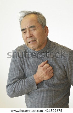 Elderly man suffering from bad pain in his chest heart attack - stock photo