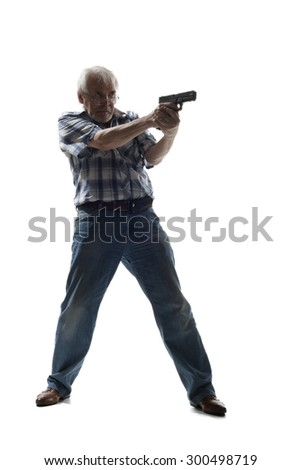 Elderly man takes aim from a gun isolated on white background - stock photo