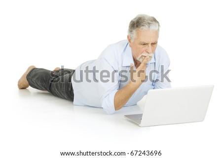elderly man using laptop - stock photo