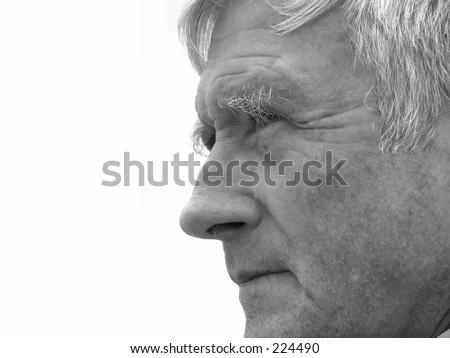 Elderly man watching something - stock photo