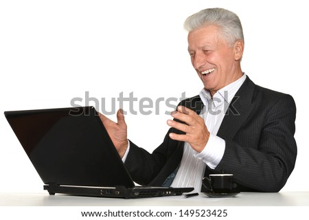 elderly man with a laptop on a white background - stock photo