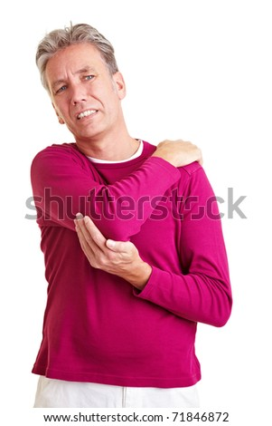 Elderly man with back pain holding his aching shoulder - stock photo