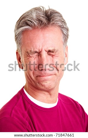 Elderly man with grey hair grimacing with disgust - stock photo
