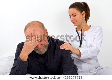 Elderly man with his caregiver at home - stock photo