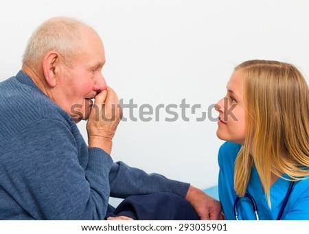 Elderly man with influenza symptoms at the doctor for a medical check-up.