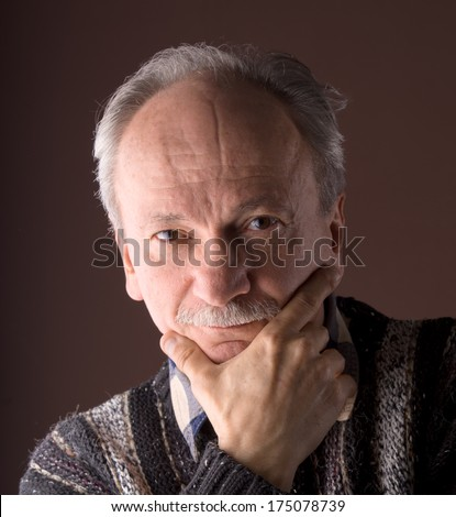 Elderly man with serious expression
