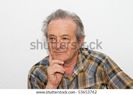 Elderly man with thoughtful expression - stock photo