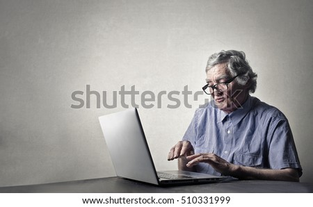 Elderly man working at pc
