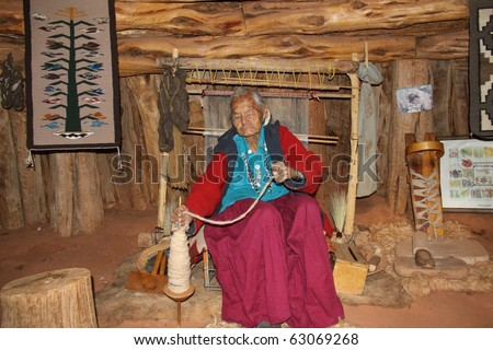 elderly navajo woman demonstrating weaving - stock photo