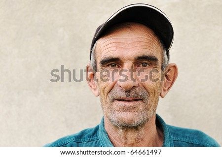 Elderly, old, mature man with hat, portrait - stock photo
