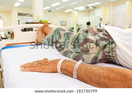 elderly patient lie down on bed in emergency room in rural hospital ,Thailand - stock photo