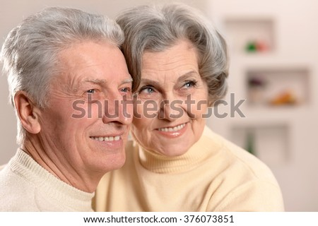 Elderly people sitting on couch