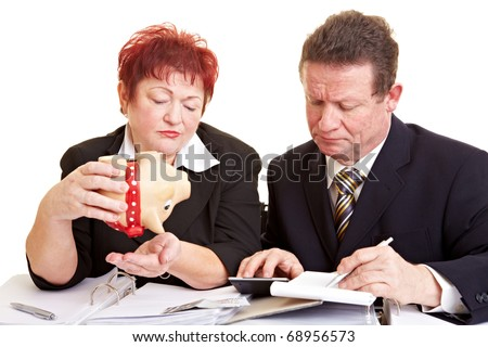 Elderly people with empty piggy bank lacking money - stock photo