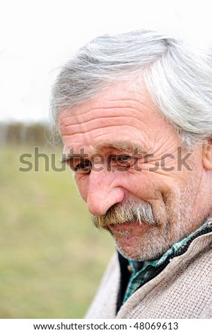 Elderly person, portrait in natural pose