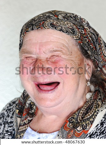 Elderly person, portrait in natural pose laughing - stock photo