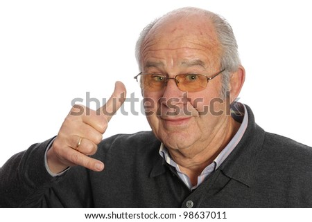 Elderly person with a statement to make a call with your hand