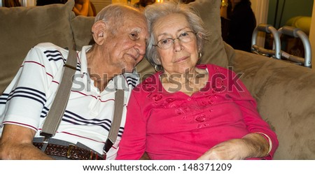 Elderly 80 plus year old couple in an affectionate pose. - stock photo
