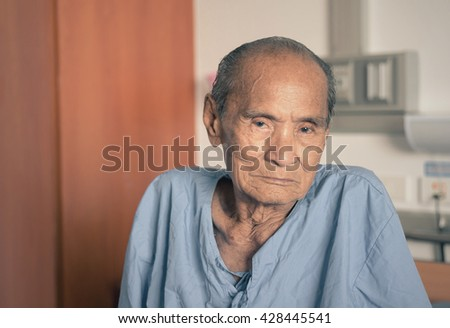 Elderly 80 plus year old man in a hospital bed.