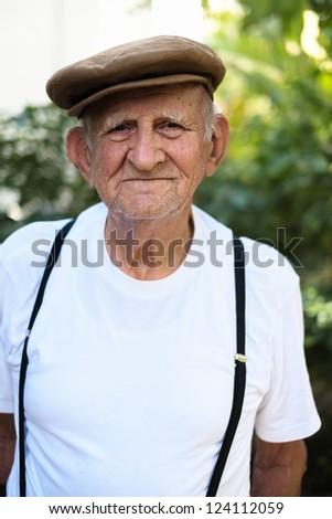 Elderly 80 plus year old man outdoor portrait. - stock photo