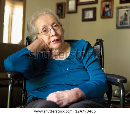 Elderly 80 plus year old woman portrait in a home setting. - stock photo