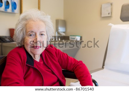 Elderly 80 plus year old woman with Alzheimer in a medical office setting. - stock photo