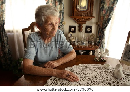 Elderly Senior Citizen Looking Out a Window in Contemplation