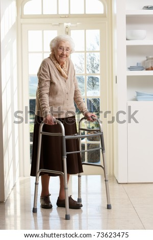 Elderly Senior Woman Using Walking Frame - stock photo