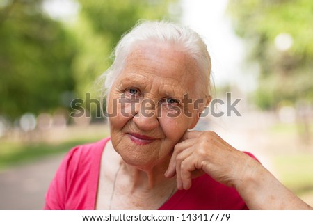 Elderly smiling woman - stock photo