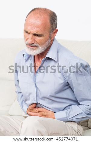 Elderly stomach ache man - stock photo