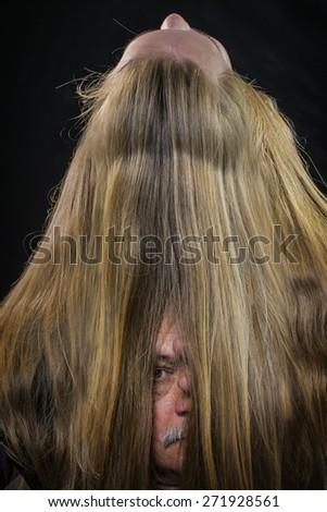 Elderly the man looks through female hair - stock photo