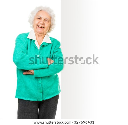 elderly woman alongside of ad board over white background - stock photo
