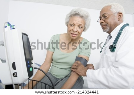 Elderly woman and senior practitioner during medical check-up - stock photo