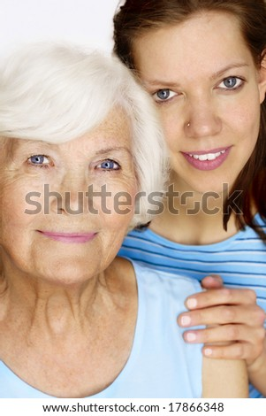 Elderly woman and young woman together for a portrait - stock photo
