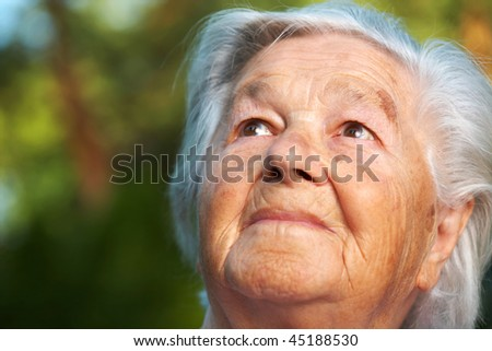 Elderly woman being pensive - stock photo