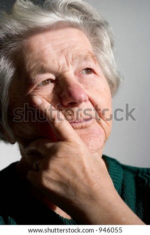 Elderly woman bringing back memories.Focus on her left eye.
