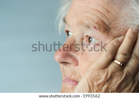 Elderly woman brings back memories - stock photo