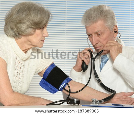 Elderly woman came to the doctor. measuring blood preassure