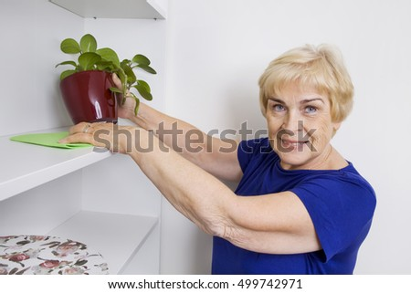 Elderly woman cleaning
