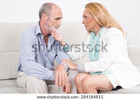 Elderly woman comforting a friend - stock photo
