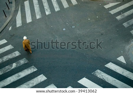 elderly woman crossing the street