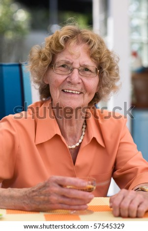 Elderly Woman Drinking Liqueur Outdoors