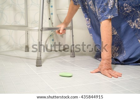 elderly woman falling in bathroom because slippery surfaces - stock photo
