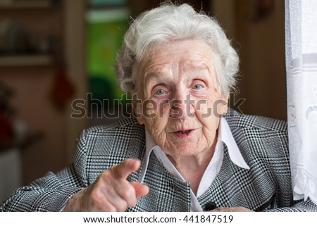 Elderly woman gesturing in the conversation. - stock photo