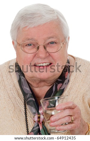 Elderly woman holding a glass of water - isolated