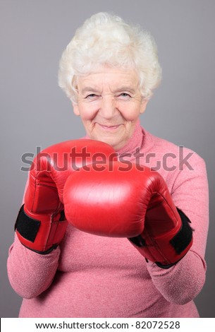 elderly woman in boxing-gloves