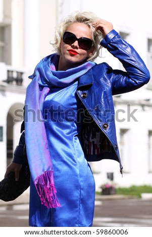 elderly woman in sun glasses - stock photo