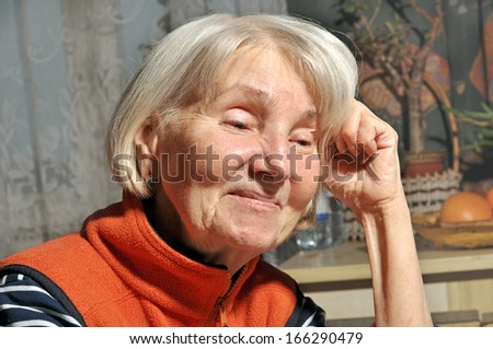 elderly woman in the kitchen smiling