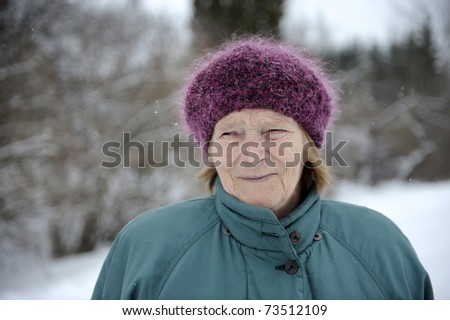 elderly woman in winter - stock photo