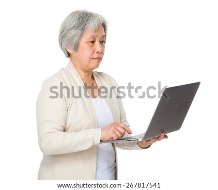 Elderly woman learn to use notebook - stock photo