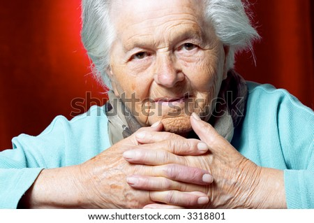 Elderly woman looking at camera, portrait. - stock photo